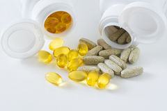 Fish oil and garlic tablets Royalty Free Stock Image