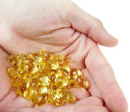 Fish oil in hands Stock Images