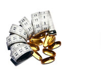 Fish oil and measuring tape Stock Images