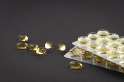 Fish oil omega3 capsules biologically active additive on a light background close-up side view stock image