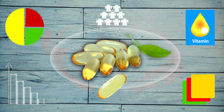 Fish oil omega 3 gel capsules on wooden background. Royalty Free Stock Photos