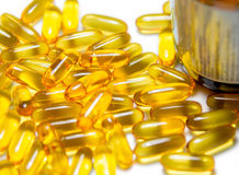 Fish oil pills with brown  bottle isolated Royalty Free Stock Photography