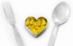 Fish oil pills for meal isolated royalty free stock photos