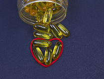 Fish oil, red heart and jar Royalty Free Stock Images