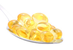 Fish oil in spoon Royalty Free Stock Image