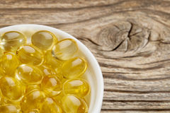 Fish oil supplement  capsules Royalty Free Stock Photos
