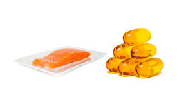 Fish oil supplement product capsules with salmon on dish Stock Photography