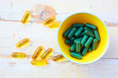 Fish oil vitamins  and herbal pills Royalty Free Stock Photo