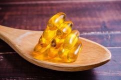 Fish oil on wooden spoon with Stock Photo