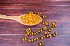 Fish oil on wooden spoon Stock Photos