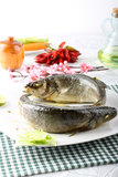 Fish with olive oil and lemon Stock Photography