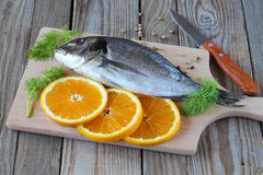 Fish with orange and dill Stock Photo