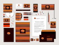 Fish and ornaments in ethnic style. The bright corporate identity with fish and ornaments in ethnic style. Samples of business cards, a disk, a flag, a pen, a stock illustration