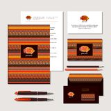 Fish and ornaments in ethnic style. The bright corporate identity with fish and ornaments in ethnic style. Samples of business cards, a flash card, a pen, an vector illustration
