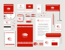 Fish and ornaments in ethnic style. The bright corporate identity with fish and ornaments in ethnic style. Samples of business cards, a disk, a flag, a pen, a Stock Photography