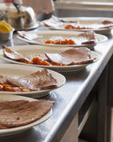 Fish over plates Royalty Free Stock Photo