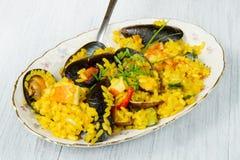 Fish paella Stock Images