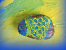 Fish painted on stone Royalty Free Stock Photography