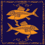 Fish pair gold label. Fish pair gold on blue with artistic frame label Royalty Free Stock Photo