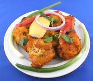 Fish pakora. Sizzling fish pakora with onions and lemon Stock Image
