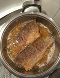 Fish in the pan. With fat Stock Image