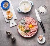 Fish patties making with Minced fish ,egg, shrimps , onion and soaked bread on kitchen table background with knife, top view. Seaf Royalty Free Stock Photo