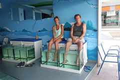 Fish pedicure spa. Faliraki, Rhodes island, Greece. Fish pedicure spa salon in Faliraki resort, Rhodes island, Greece. September 2015 Stock Photo