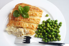 Fish pie with peas Royalty Free Stock Photo