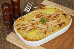 Fish pie on wooden table Royalty Free Stock Photos