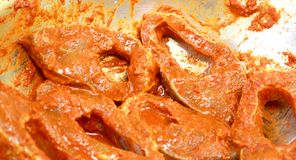 Fish pieces with spicy masala ready for cook. This is a south indian masala fry stock images
