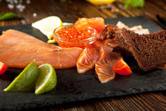 Fish Plate on Black DIsh Stock Photography