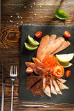 Fish Plate on Black DIsh Royalty Free Stock Photography