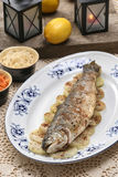 Fish plate in greek tavern. Roasted trout on onion. Royalty Free Stock Photos