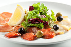 Fish Plate with Salad Leaf. Cured FIsh with Lemon and Salad Leaf Royalty Free Stock Image