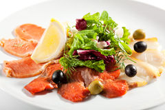 Fish Plate with Salad Leaf. Cured FIsh with Lemon and Salad Leaf Stock Photography
