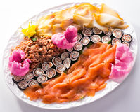 Fish plate with salmon, crabs and sushi. Fish plate with salmon, crabs and vegetarian sushi Stock Photo
