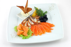 Fish plate with vegetables Royalty Free Stock Photography