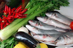 Fish plate with vegetables Royalty Free Stock Photo