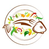 Fish on a plate with vegetables. And cutlery Royalty Free Stock Photos