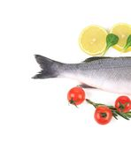 Fish on a plate with vegetables and lemon Royalty Free Stock Photo