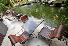Fish pond and chair Royalty Free Stock Photography