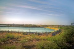 Industry of fish farming in Asia. Fish ponds dam is fenced off from big lake. industry of fish farming in Asia Royalty Free Stock Images