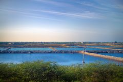 Industry of fish farming in Asia. Fish ponds dam is fenced off from big lake. industry of fish farming in Asia Royalty Free Stock Photos