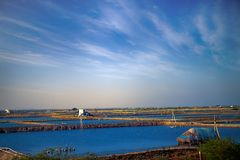 Industry of fish farming in Asia. Fish ponds dam is fenced off from big lake. industry of fish farming in Asia Stock Photos