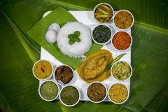 Bangla Cuisine Vorta, vaji, fish curry and vegetables curry platter. The fish is popular food amongst the people of South Asia and in the Middle East, but Royalty Free Stock Photography