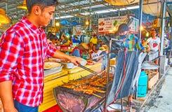 Fish and pork barbecue in Talad Saphan Phut market, Bangkok, Thailand