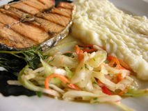 Fish with potato. Lox with potato puree and sauerkraut royalty free stock photography