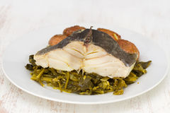 Fish with potato and vegetables on white plate Stock Photography