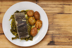 Fish with potato and vegetables on white plate Royalty Free Stock Images