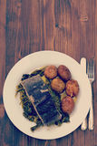 Fish with potato and vegetables on white plate Royalty Free Stock Photography